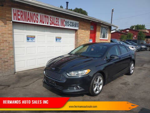 2014 Ford Fusion for sale at HERMANOS AUTO SALES INC in Hamilton OH