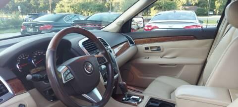 2009 Cadillac SRX for sale at DADA AUTO INC in Monroe NC