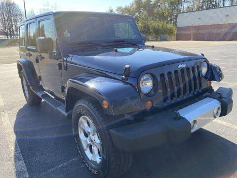 2013 Jeep Wrangler Unlimited for sale at CU Carfinders in Norcross GA