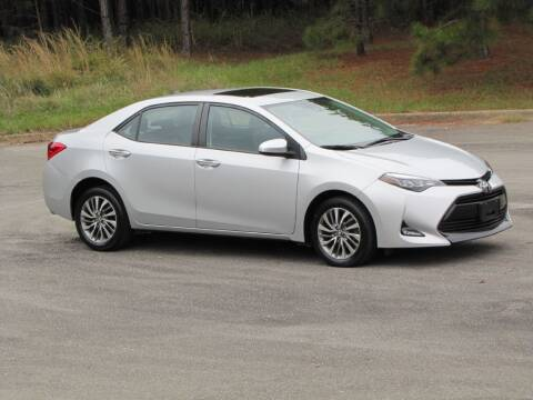 2017 Toyota Corolla for sale at Hometown Auto Sales - Cars in Jasper AL