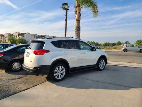 2013 Toyota RAV4 for sale at E and M Auto Sales in Bloomington CA