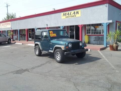 1997 Jeep Wrangler for sale at Atayas Motors INC #1 in Sacramento CA