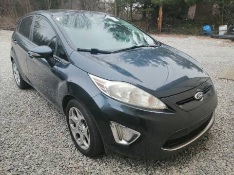 2011 Ford Fiesta for sale at KRIS RADIO QUALITY KARS INC in Mansfield OH