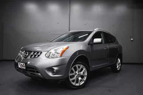 2011 Nissan Rogue for sale at TOPLINE AUTO GROUP in Kent WA