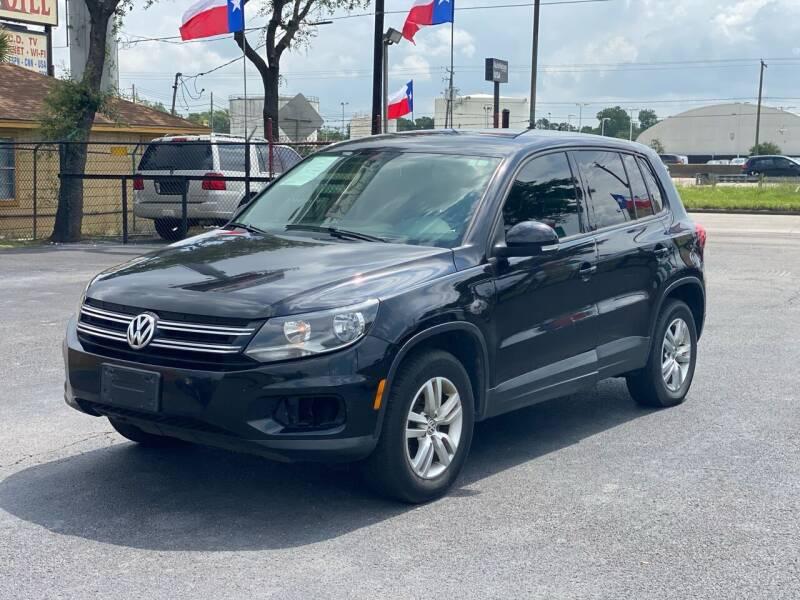2014 Volkswagen Tiguan for sale at ASTRO MOTORS in Houston TX