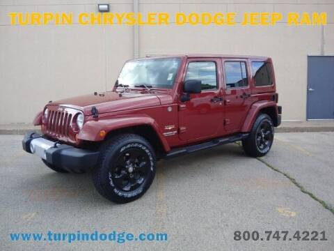 2013 Jeep Wrangler Unlimited for sale at Turpin Dodge Chrysler Jeep Ram in Dubuque IA