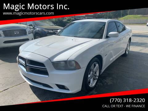2011 Dodge Charger for sale at Magic Motors Inc. in Snellville GA