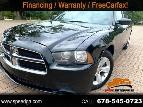 2014 Dodge Charger for sale at JES Auto Sales LLC in Fairburn GA