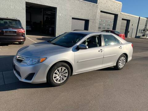 2014 Toyota Camry for sale at The Car Buying Center in St Louis Park MN
