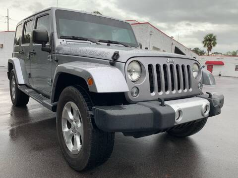 2014 Jeep Wrangler Unlimited for sale at Consumer Auto Credit in Tampa FL