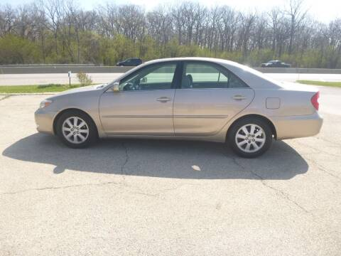 2003 Toyota Camry for sale at NEW RIDE INC in Evanston IL
