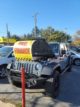 2015 Jeep Wrangler Unlimited for sale at J & J Used Cars inc in Wayne MI