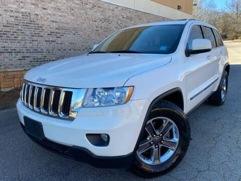 2012 Jeep Grand Cherokee for sale at Gwinnett Luxury Motors in Buford GA