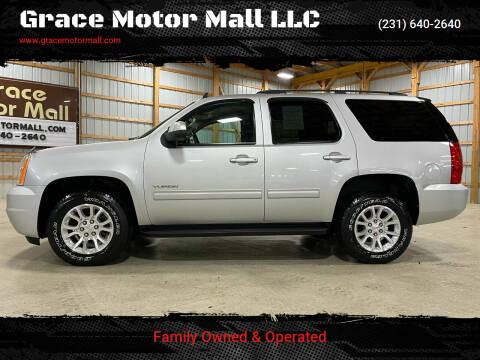 2013 GMC Yukon for sale at Grace Motor Mall LLC in Traverse City MI