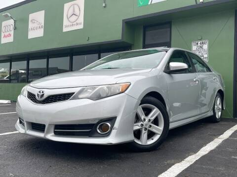 2014 Toyota Camry for sale at KARZILLA MOTORS in Oakland Park FL
