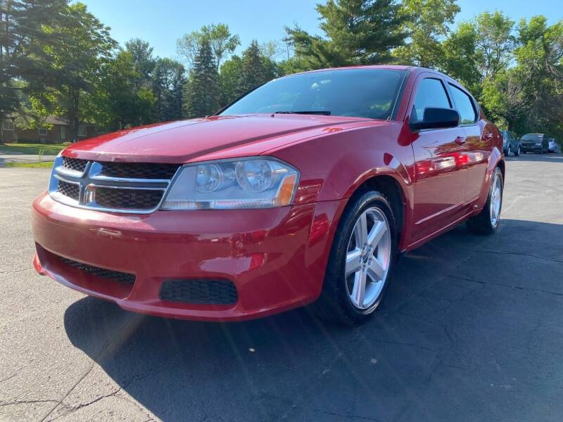 2013 Dodge Avenger for sale at Northstar Auto Sales LLC in Ham Lake MN