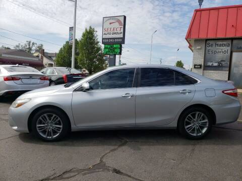2015 Toyota Camry for sale at Select Auto Group in Wyoming MI