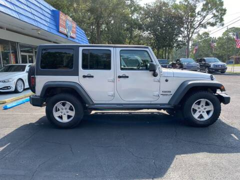 2011 Jeep Wrangler Unlimited for sale at INTERSTATE AUTO SALES in Pensacola FL