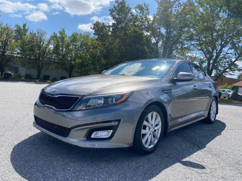 2015 Kia Optima for sale at Triple A's Motors in Greensboro NC