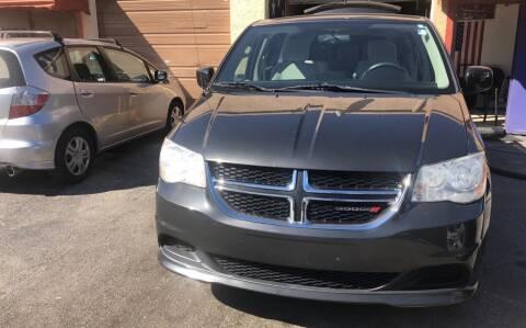 2012 Dodge Grand Caravan for sale at Auto Credit & Finance Corp. in Miami FL