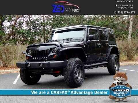 2011 Jeep Wrangler Unlimited for sale at Zed Motors in Raleigh NC