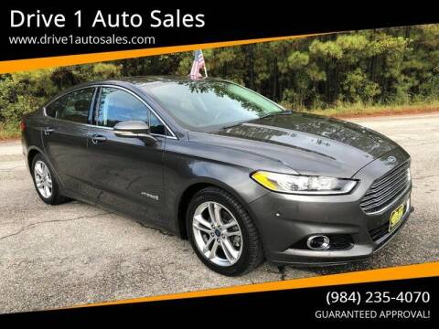 2016 Ford Fusion Hybrid for sale at Drive 1 Auto Sales in Wake Forest NC