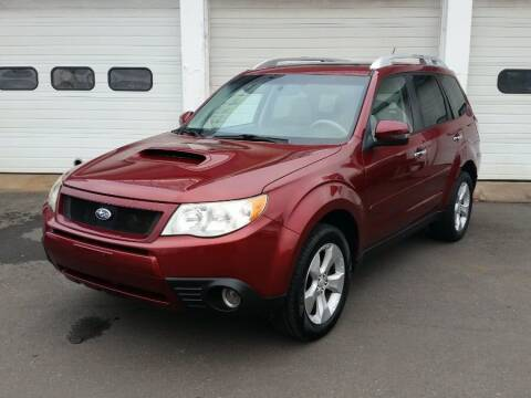 2011 Subaru Forester for sale at Action Automotive Inc in Berlin CT
