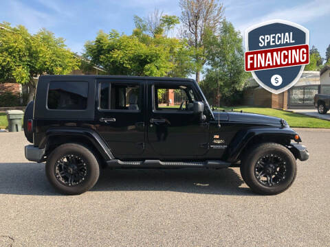 2009 Jeep Wrangler Unlimited for sale at Carmelo Auto Sales Inc in Orange CA