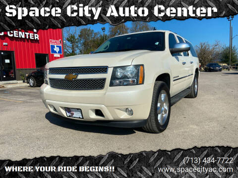 2014 Chevrolet Suburban for sale at Space City Auto Center in Houston TX