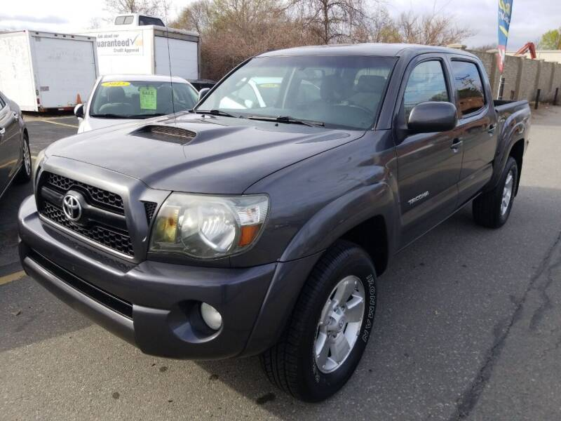 2011 Toyota Tacoma for sale at Howe's Auto Sales in Lowell MA