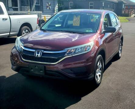 2015 Honda CR-V for sale at MGM Auto Sales in Cortland NY
