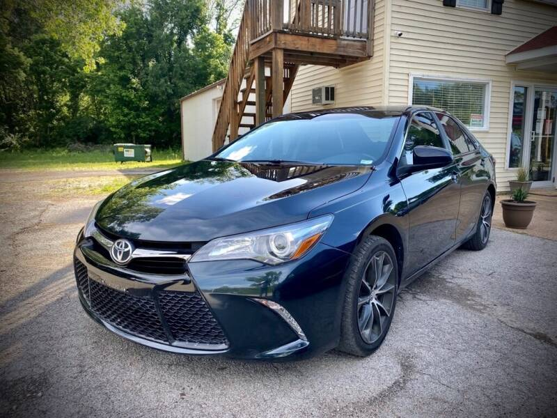 2016 Toyota Camry for sale at Unique LA Motor Sales LLC in Byrnes Mill MO