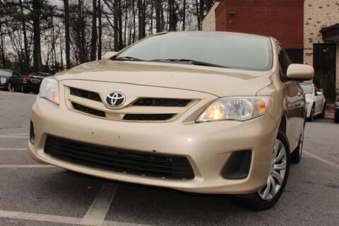 2012 Toyota Corolla for sale at Atlanta Unique Auto Sales in Norcross GA