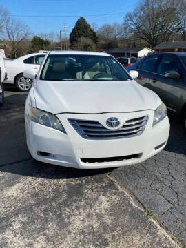 2007 Toyota Camry Hybrid for sale at LAKE CITY AUTO SALES in Forest Park GA