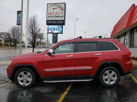 2011 Jeep Grand Cherokee for sale at Select Auto Group in Wyoming MI