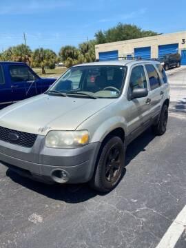 2005 Ford Escape for sale at MLG Auto Group Inc. in Pompano Beach FL
