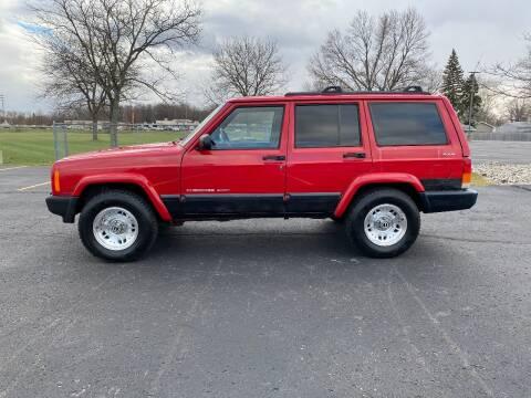 2000 Jeep Cherokee for sale at Caruzin Motors in Flint MI