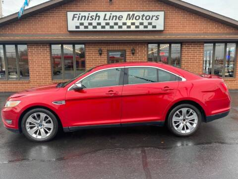 2010 Ford Taurus for sale at FINISHLINE MOTORS in Canton OH