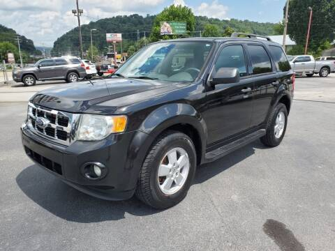 2011 Ford Escape for sale at MCMANUS AUTO SALES in Knoxville TN