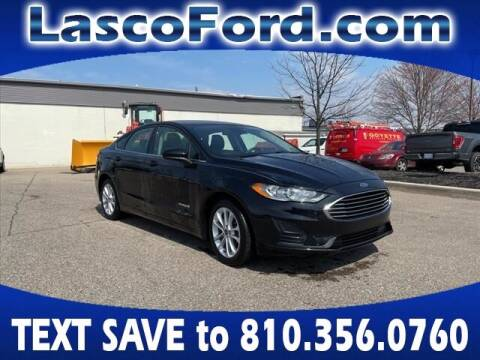 2019 Ford Fusion Hybrid for sale at LASCO FORD in Fenton MI