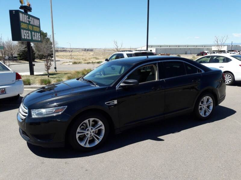 2015 Ford Taurus for sale at More-Skinny Used Cars in Pueblo CO