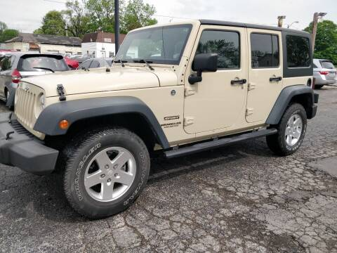 2011 Jeep Wrangler Unlimited for sale at The Car Cove, LLC in Muncie IN