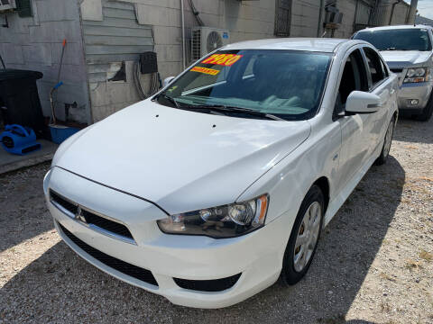 2015 Mitsubishi Lancer for sale at CHEAPIE AUTO SALES INC in Metairie LA