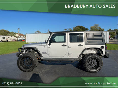 2011 Jeep Wrangler Unlimited for sale at BRADBURY AUTO SALES in Gibson City IL