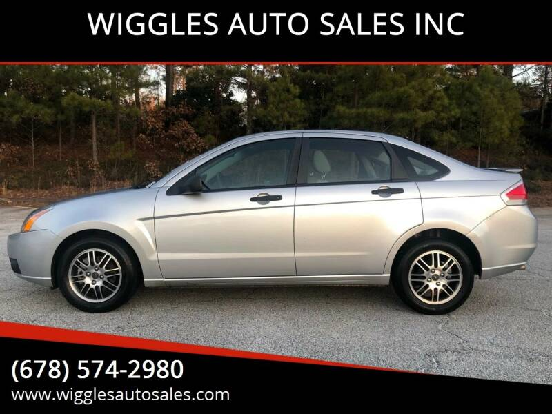 2010 Ford Focus for sale at WIGGLES AUTO SALES INC in Mableton GA