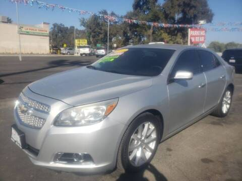 2013 Chevrolet Malibu for sale at C J Auto Sales in Riverbank CA