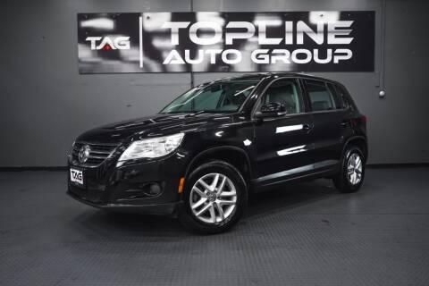 2011 Volkswagen Tiguan for sale at TOPLINE AUTO GROUP in Kent WA