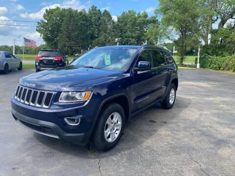 2015 Jeep Grand Cherokee for sale at Rombaugh's Auto Sales in Battle Creek MI
