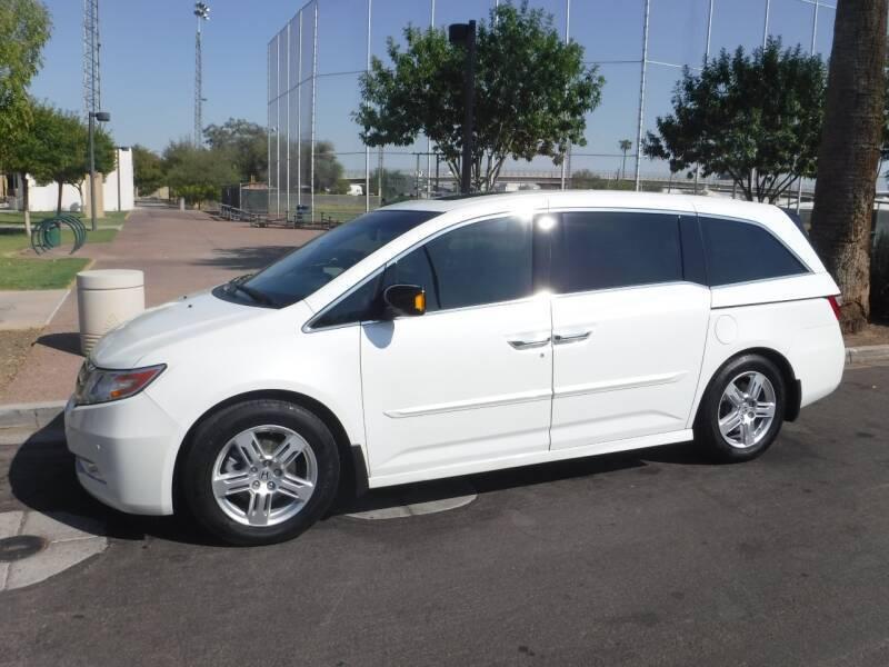 2012 Honda Odyssey for sale at J & E Auto Sales in Phoenix AZ