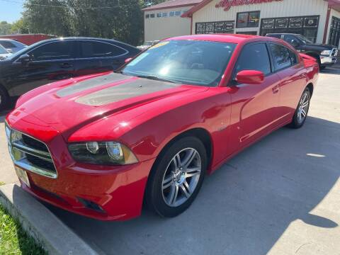 2014 Dodge Charger for sale at Azteca Auto Sales LLC in Des Moines IA